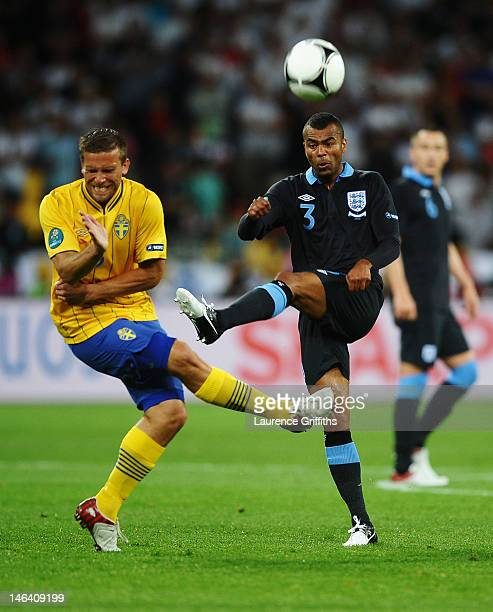 Ashley Cole of England and Anders Svensson of Sweden during the UEFA EURO 2012 group D match between Sweden and England at The Olympic Stadium on...
