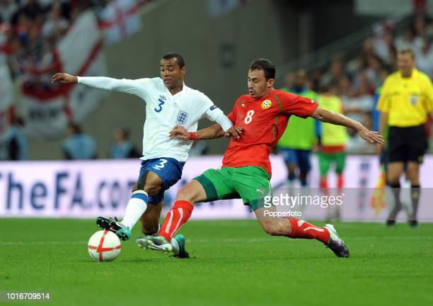 Ashley Cole of England and Chavdar Yankov of Bulgaria in action during the UEFA EURO 2012 Group G Qualifying match between England and Bulgaria at...