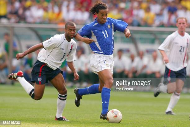 Ashley Cole of England and Ronaldinho of Brazil during the Quarter Final World Cup match between England and Brazil at Shizuoka Stadium Ecopa...