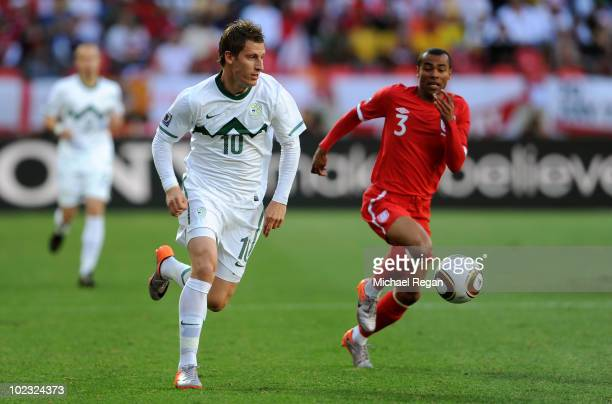 Ashley Cole of England and Valter Birsa of Slovenia chase the ball during the 2010 FIFA World Cup South Africa Group C match between Slovenia and...
