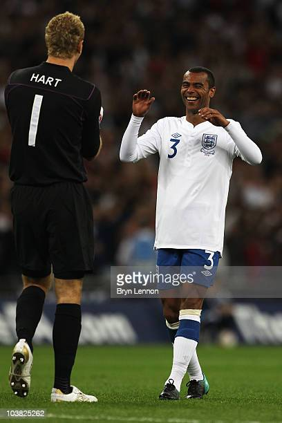 Ashley Cole of England celebrates with team mate Joe Hart as their side take a two goal lead during the UEFA EURO 2012 Group G Qualifying match...