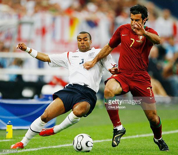 Ashley Cole of England challenges Luis Figo of Portugal during the FIFA World Cup Germany 2006 Quarterfinal match between England and Portugal played...