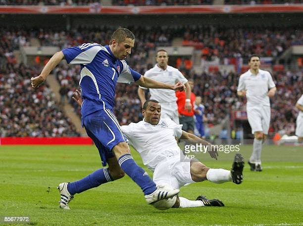 Ashley Cole of England defends against the shot from Stanislav Sestak of Slovakia during their International friendly match at Wembley Stadium in...