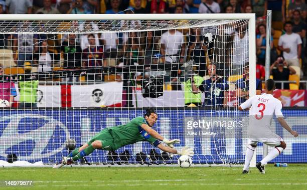 Ashley Cole of England has his penalty kick saved by Gianluigi Buffon of Italy during the UEFA EURO 2012 quarter final match between England and...