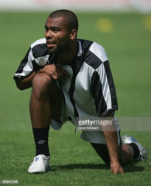 Ashley Cole of England warms up during a training session at the National Stadium on June 9 2004 near Lisbon Portugal England play France in their...
