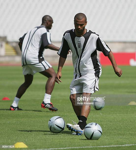 Ashley Cole of England wars up during the teams training session at the National Stadium their Euro 2004 training camp June 9 2004 near Lisbon...