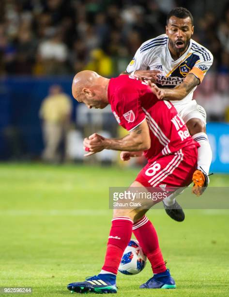 Ashley Cole of Los Angeles Galaxy collides with Aurelien Collin of New York Red Bulls during the Los Angeles Galaxy's MLS match against New York Red...