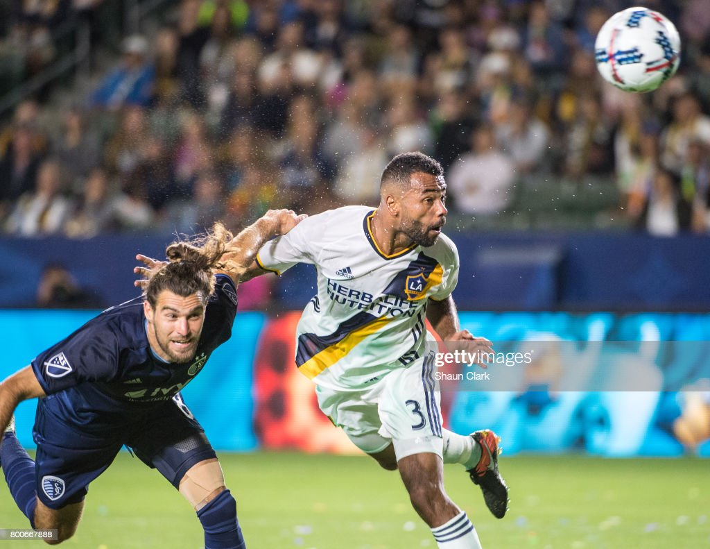Ashley Cole #3 of Los Angeles Galaxy heads the ball toward goal as Graham Zusi #8 of Sporting Kansas City defends during the Los Angeles Galaxy's MLS match against Sporting KC at the StubHub Center on June 24, 2017 in Carson, California. Sporting Kansas City won the match 2-1