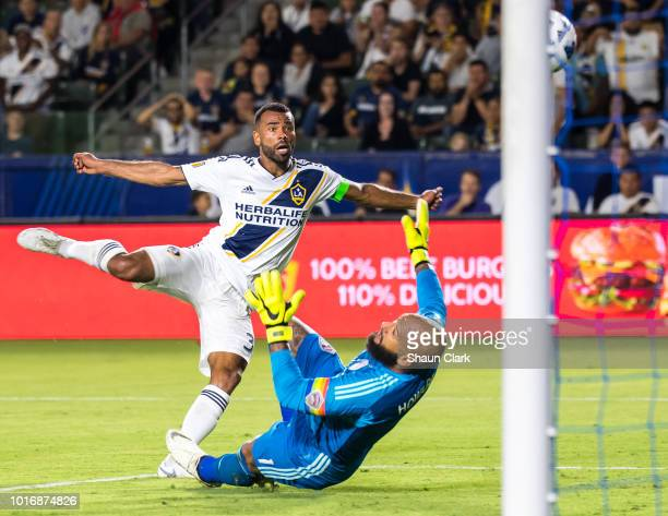 Ashley Cole of Los Angeles Galaxy scores a goal on Tim Howard of Colorado Rapidsduring the Los Angeles Galaxy's MLS match against Colorado Rapids at...