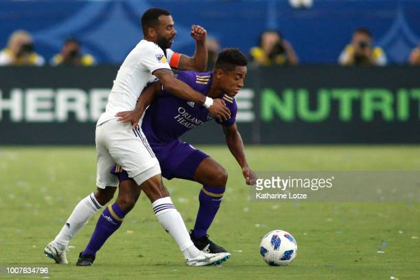 Ashley Cole of the Los Angeles Galaxy and Cristian Higuita of Orlando City SC at StubHub Center on July 29 2018 in Carson California