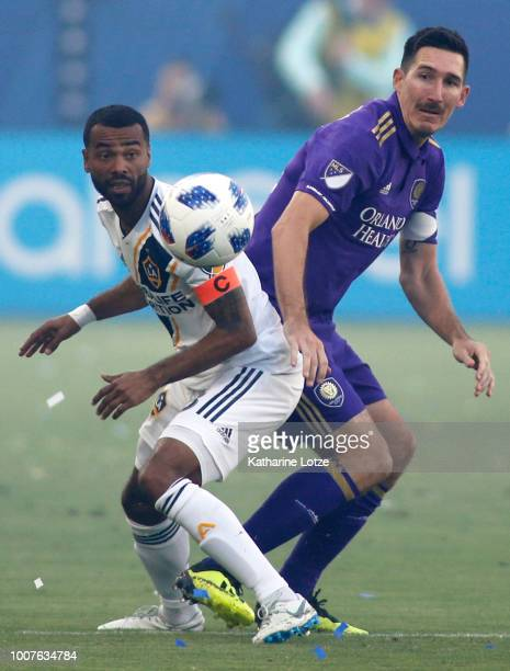 Ashley Cole of the Los Angeles Galaxy and Sacha Kljestan of Orlando City SC fight for control of the ball at StubHub Center on July 29 2018 in Carson...