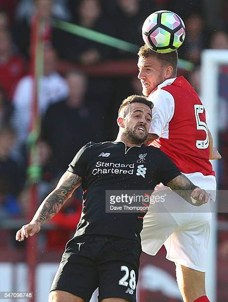 Ashley Eastham of Fleetwood Town wins the ball from Danny Ings of Liverpool during the PreSeason Friendly match between Fleetwood Town and Liverpool...