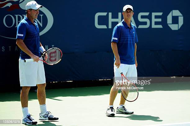 Ashley Fisher of Australia and Stephen Huss of Australia look on during their doubles match against Martin Emmrich of Germany and Andreas Siljestrom...