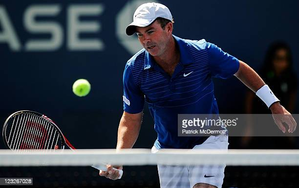 Ashley Fisher of Australia returns a shot during his doubles match with Stephen Huss of Australia against Martin Emmrich of Germany and Andreas...