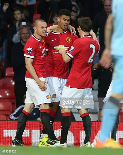 Ashley Fletcher of Manchester United U21s celebrates scoring their third goal during the Barclays U21 Premier League match between Manchester United...