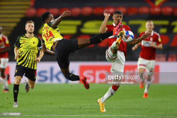 Ashley Fletcher of Middlesbrough and Nathaniel Chalobah of Watford compete for the ball during the Sky Bet Championship match between Watford and...