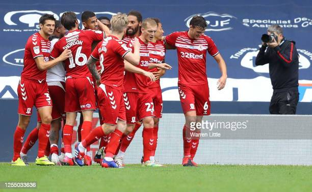 Ashley Fletcher of Middlesbrough celebrates his team's second goal with teammates during the Sky Bet Championship match between Millwall and...