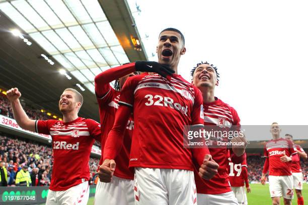 Ashley Fletcher of Middlesbrough celebrates with team mates after scoring his team's first goal during the FA Cup Third Round match between...