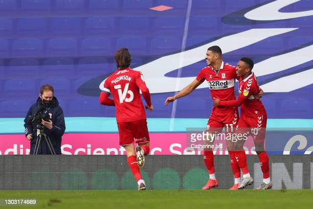 Ashley Fletcher of Middlesbrough celebrates with team mates Darnell Fisher and Jonny Howson after scoring their side's first goal during the Sky Bet...