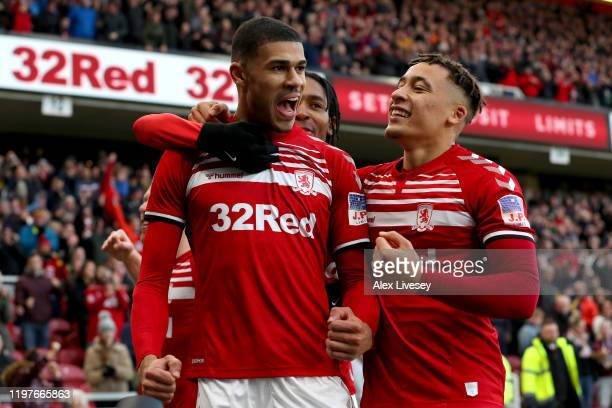 Ashley Fletcher of Middlesbrough celebrates with teammates after scoring his team's first goal during the FA Cup Third Round match between...