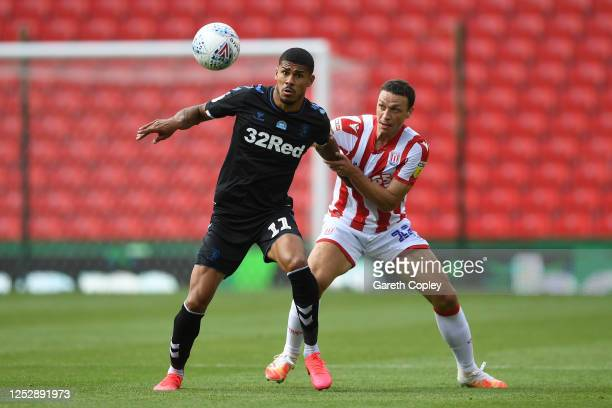 Ashley Fletcher of Middlesbrough holds off James Chester of Stoke City during the Sky Bet Championship match between Stoke City and Middlesbrough at...