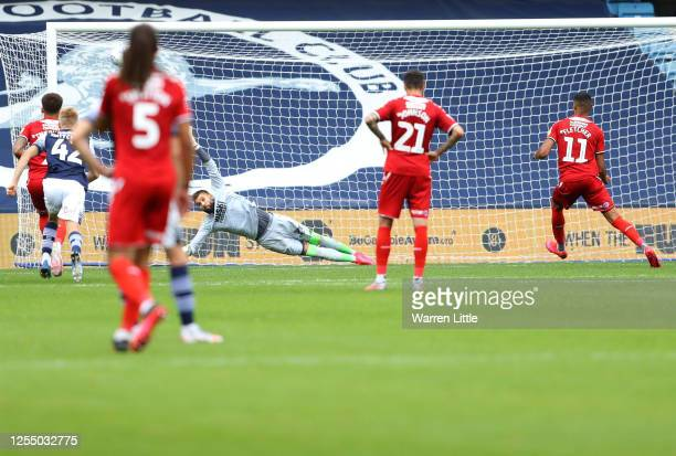 Ashley Fletcher of Middlesbrough scores his team's second goal with a penalty against goalkeeper Bartosz Bialkowski of Millwall during the Sky Bet...