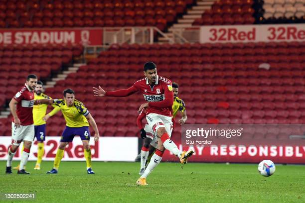 Ashley Fletcher of Middlesbrough scores their side's second goal from the penalty spot during the Sky Bet Championship match between Middlesbrough...
