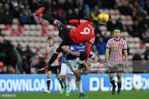 Ashley Fletcher of Sunderland is upended by Cameron CarterVickers of Ipswich during the Sky Bet Championship match between Sunderland and Ipswich...