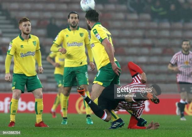 Ashley Fletcher of Sunderland tangles with Grant Hanley of Norwich during the Sky Bet Championship match between Sunderland and Norwich City at...