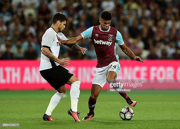 Ashley Fletcher of West Ham holds off pressure from Fabricio Silva Dornellas of FC Astra Giurgiu during the UEFA Europa League match between West Ham...