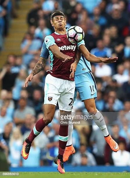 Ashley Fletcher of West Ham United controlls the ball as he is put under pressure from Aleksander Kolorov of Manchester City during the Premier...