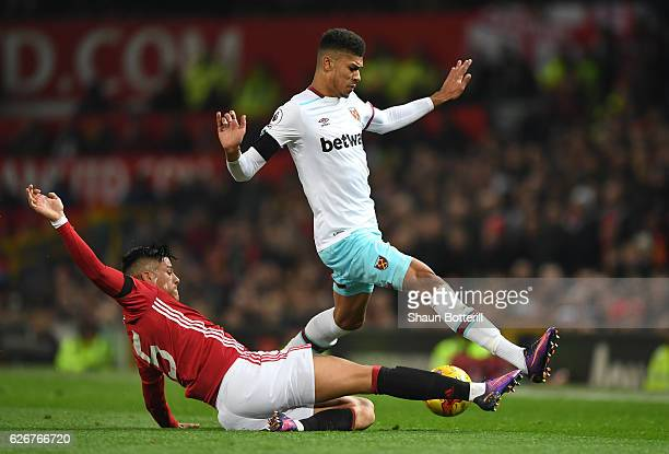 Ashley Fletcher of West Ham United is tackled by Marcos Rojo of Manchester United during the EFL Cup quarter final match between Manchester United...