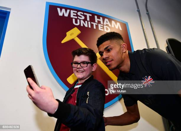 Ashley Fletcher of West Ham United poses for a photograph with a fan during a West Ham United family fun day at London Stadium on February 15 2017 in...