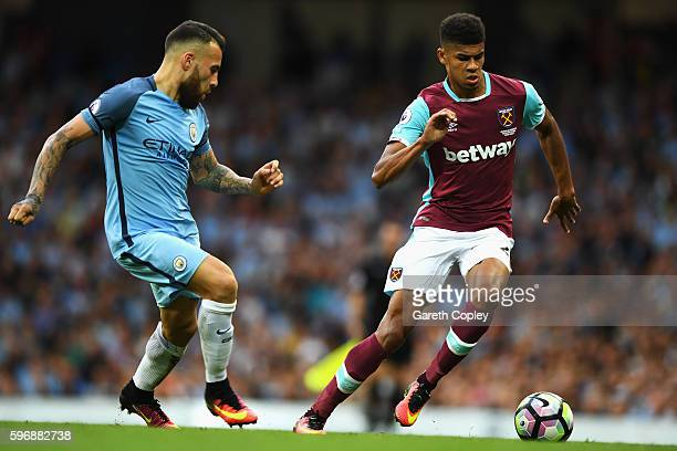 Ashley Fletcher of West Ham United takes on Nicolas Otamendi of Manchester City during the Premier League match between Manchester City and West Ham...