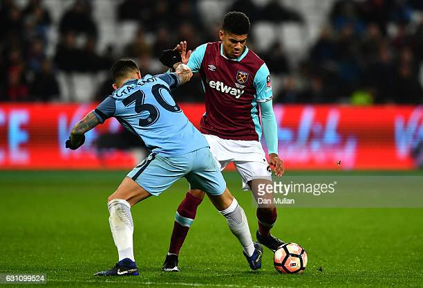 Ashley Fletcher of West Ham United takes on Nicolas Otamendi of Manchester City during The Emirates FA Cup Third Round match between West Ham United...