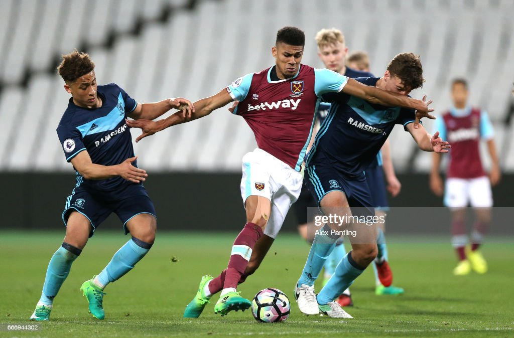 Ashley Fletcher of West Ham United takes on the Middlesbrough defence during the Premier League 2 match between West Ham United and Middlesbrough at London Stadium on April 10, 2017 in Stratford, England.