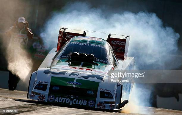 Ashley Force driver of the Castrol GTX funny car does a burn out during qualifying for the NHRA Carolinas Nationals at the Zmax Dragway on September...