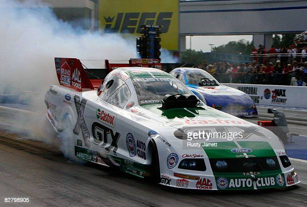 Ashley Force driver of the Castrol GTX funny car does her burn out before being fastest in the first round qualifying for the NHRA Carolinas...