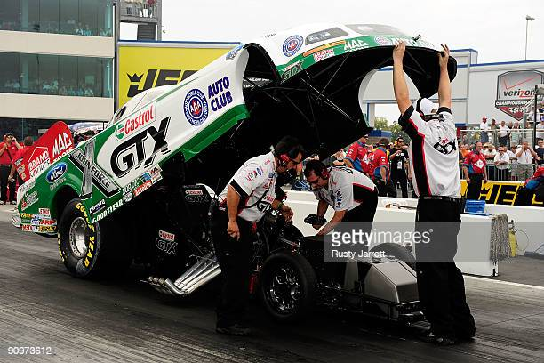 Ashley Force Hood driver of the Castrol GTX Ford has adjustments made by her crew qualifying for the NHRA Carolinas Nationals on September 18 2009 at...