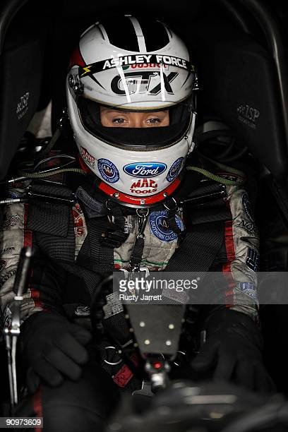 Ashley Force Hood driver of the Castrol GTX Ford prepares to drive during qualifying for the NHRA Carolinas Nationals on September 19 2009 at Zmax...