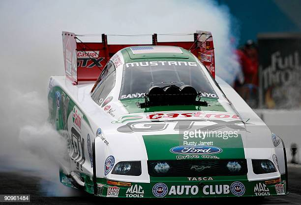 Ashley Force Hood heats her tires during first round qualifying for the NHRA Carolinas Nationals on September 18 2009 at Zmax Dragway in Concord...