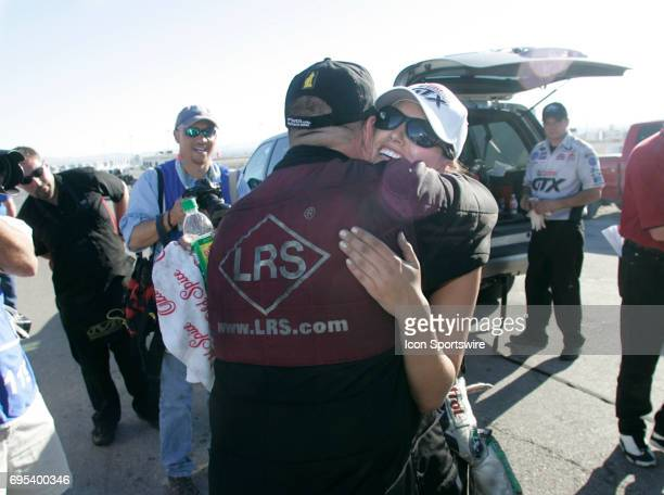 Ashley Force hugs Tim Wilkerson after finishing second to him at the 2008 NHRA SummitRacingcom Nationals at The Strip at the Las Vegas Motor Speedway...