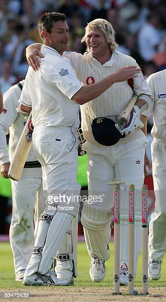 Ashley Giles and Matthew Hoggard of England celebrate victory during day four of the Fourth npower Ashes Test match between England and Australia at...