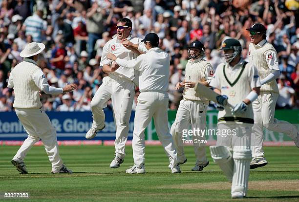 Ashley Giles of England celebrates the wicket of Michael Clarke of Australia with team mates during day two of the Second npower Ashes Test match...
