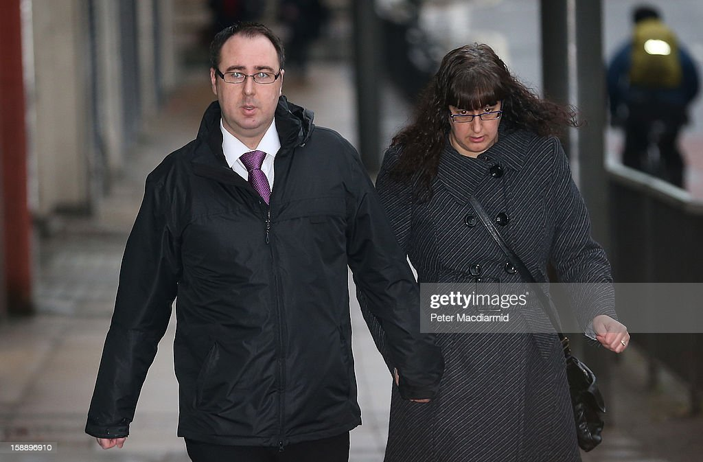 Ashley Gill-Webb (L) arrives at Stratford Magistrates Court on January 3, 2013 in London, England. Mr Gill-Webb has pleaded not guilty to using threatening words or actions with intent to cause harassment, alarm or distress after a bottle was seen to be thrown on to the athletics running track at the start of the men's 100m final at the London 2012 Olympics in August 2012.