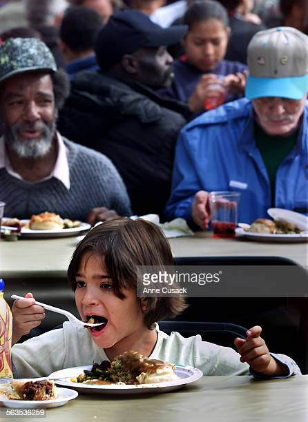 Ashley Gomez age 8 enjoys the holiday meal. Her mother Cynthia Haro brought her to the meal. Thousands of hungry Angelenos were served a turkey...