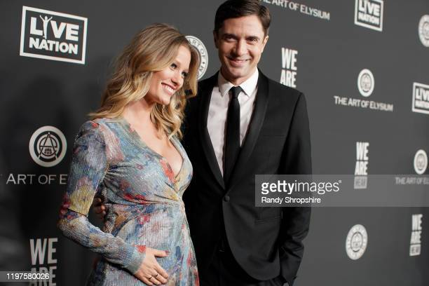 Ashley Grace and Topher Grace attend The Art Of Elysium's 13th Annual Celebration Heaven at Hollywood Palladium on January 04 2020 in Los Angeles...