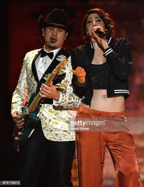 Ashley Grace Perez Mosa of HaAsh performs with a member of Bronco onstage at the 18th Annual Latin Grammy Awards at MGM Grand Garden Arena on...