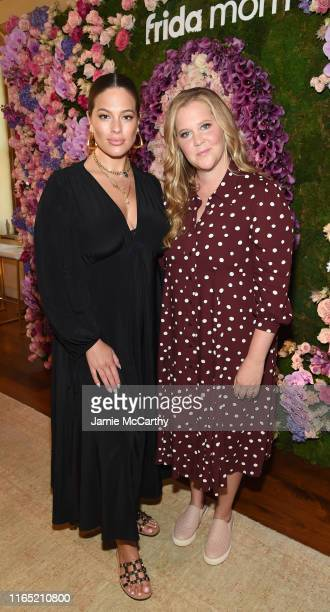 Ashley Graham and Amy Schumer attend as Arianna Huffington and Chelsea Hirschhorn host Frida Mom Launch Dinner With Amy Schumer on July 30 2019 in...