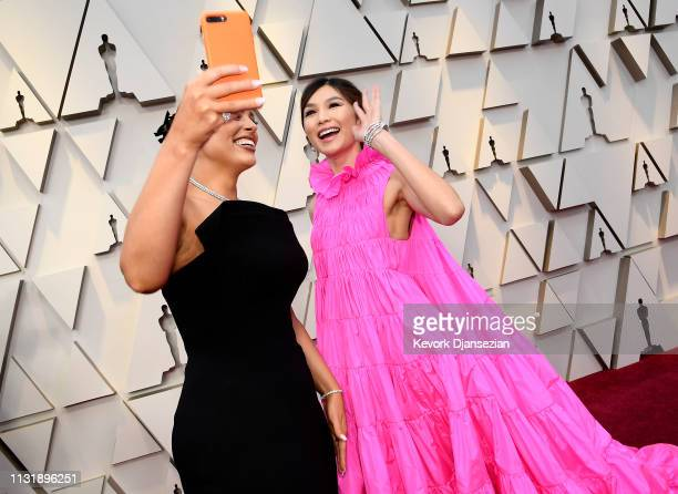 Ashley Graham and Gemma Chan attend the 91st Annual Academy Awards at Hollywood and Highland on February 24 2019 in Hollywood California